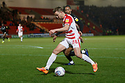 James Coppinger of Doncaster Rovers goes past Barnsley defender Ethan Pinnock (5) during the EFL Sky Bet League 1 match between Doncaster Rovers and Barnsley at the Keepmoat Stadium, Doncaster, England on 15 March 2019.
