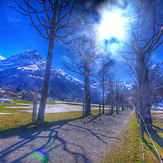 A sun-bathed trail in Engelberg on a bright Spring morning beckons towards the Rotstöckli & Titlus peaks (HDR Version)