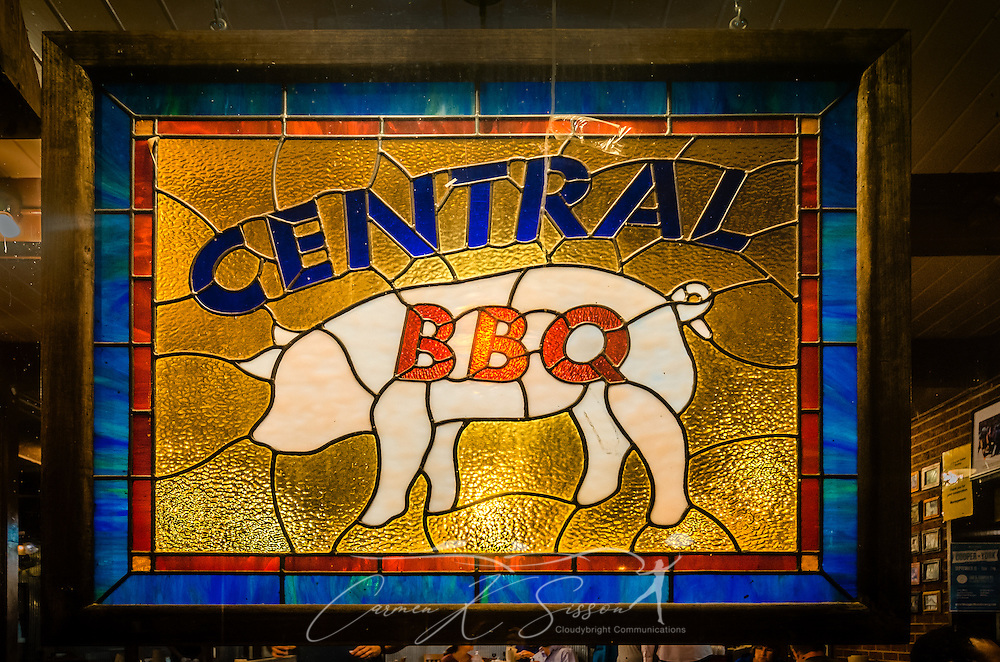 A pig-themed stained glass window hangs inside Central BBQ, Sept. 14, 2015, on Central Aveue in Memphis, Tennessee. The restaurant was founded in 2002 and specializes in slow-smoked, Memphis-style ribs. Their barbecue is consistently ranked among the best in Memphis and has been featured in numerous magazines and television shows. (Photo by Carmen K. Sisson/Cloudybright)