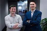 AssuredLeads VP of Sales Zach Anderson, left, and CEO Travis Batiza stand for a portrait on the 6th floor of the former Oscar Mayer headquarters building in Madison, WI on Friday, May 17, 2019.