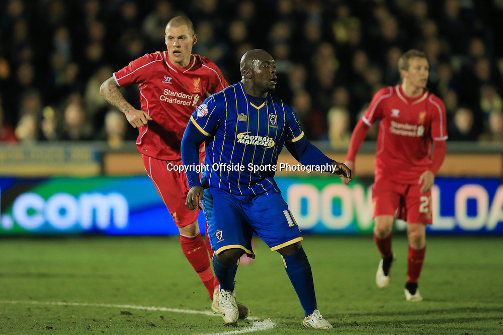 5 January 2015 - The FA Cup 3rd Round - AFC Wimbledon v Liverpool - Adebayo Akinfenwa of AFC Wimbledon in action with Martin Skrtel of Liverpool - Photo: Marc Atkins / Offside.