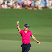 CHARLOTTE, NC - AUGUST, 14 2017:  Justin Thomas gestures to the cheering crowd as he finished his last put on 18th green at the 2017 PGA Championship at Quail Hollow Club.