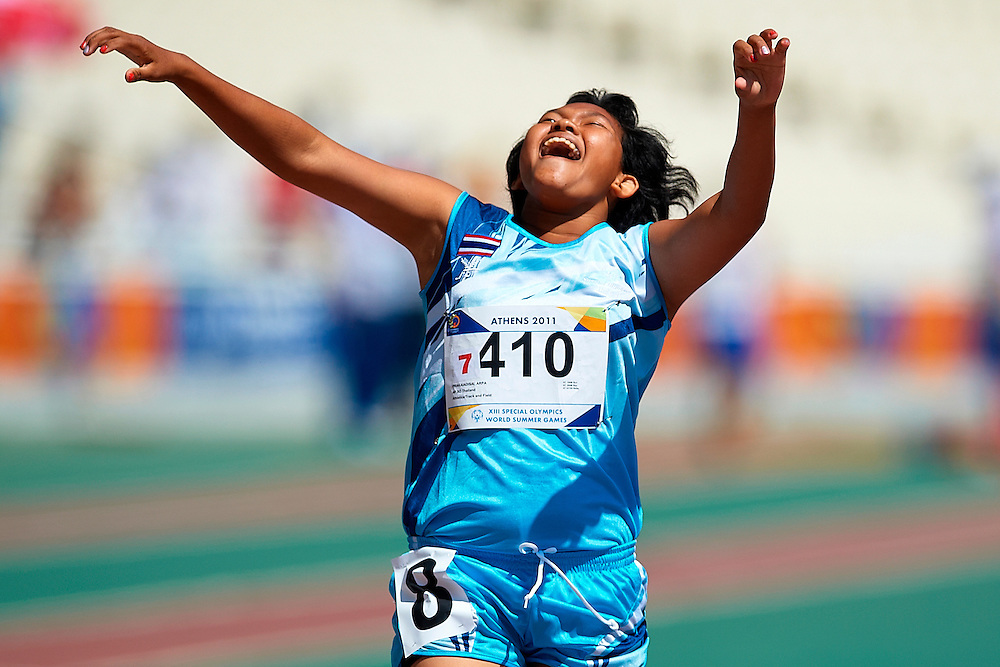 03.07.2011 Special Olympics World Summer Games from Athens. An athlete celebrates victory after winning her serie in 200m