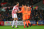 Stoke City's Peter Crouch gestures to Liverpool's Emre Can during the Premier League match between Stoke City and Liverpool at the Bet365 Stadium, Stoke-on-Trent, England on 29 November 2017. Photo by John Potts.