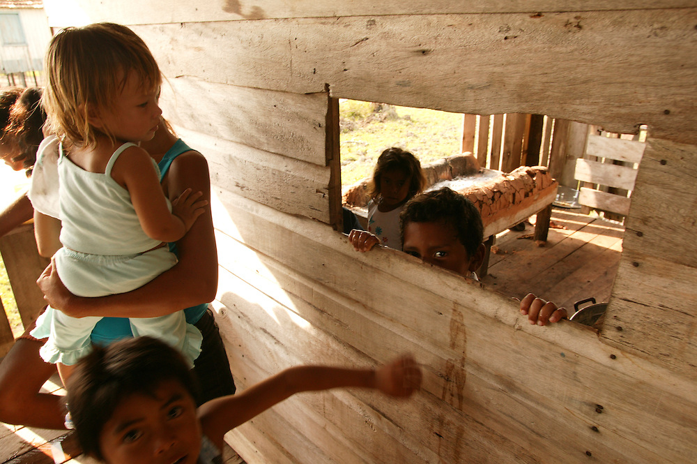 Nov. 13th, 2003. Children play during a community meeting at Ipiranga on the Guajara River in Para State, Brazil to talk about forming an extractive reserve of forest land with Greenpeace.