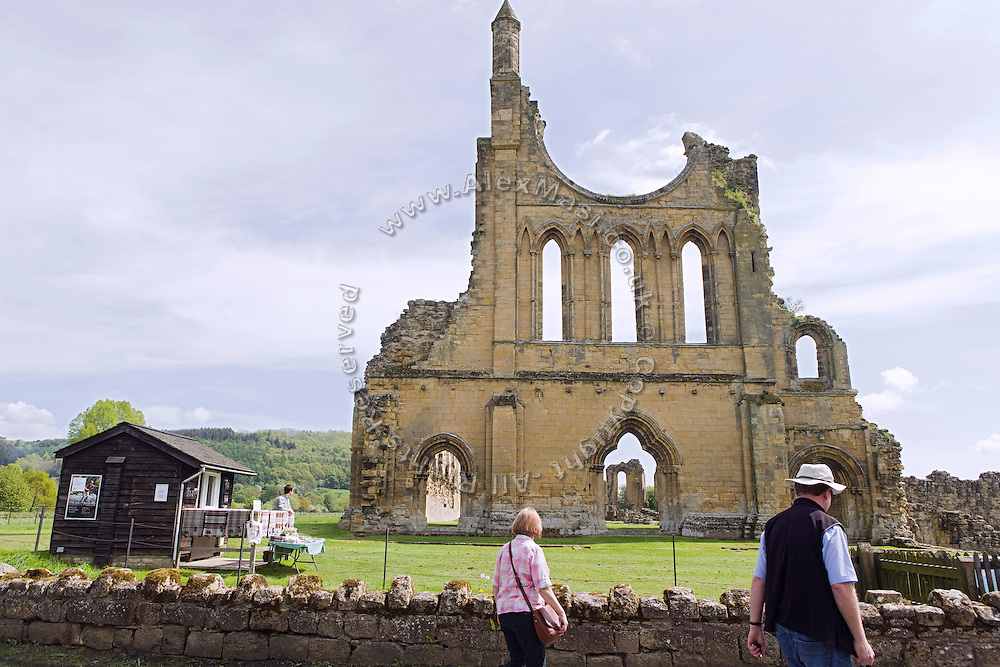 Tourists are visiting Byland Abbey in Kilburn, Yorkshire, England, United Kingdom.
