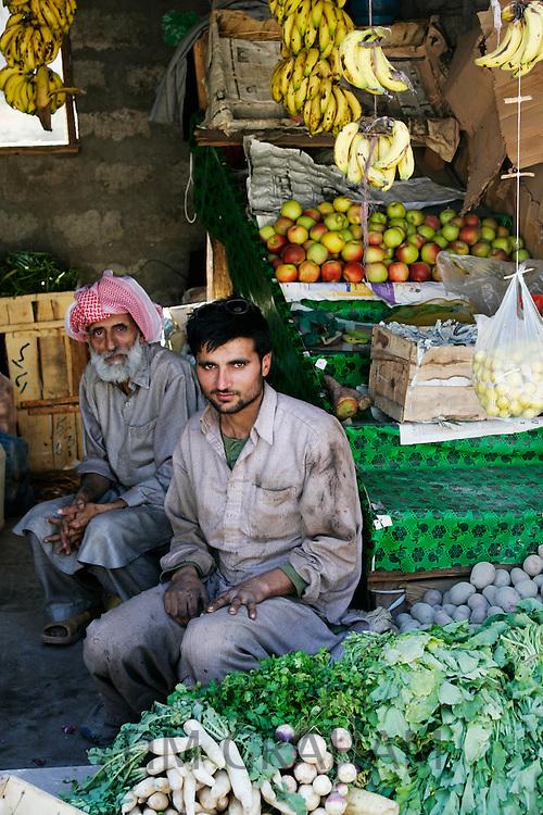 Pakistani fruit and vegetable sellers in village of Pattika, Pakistan
