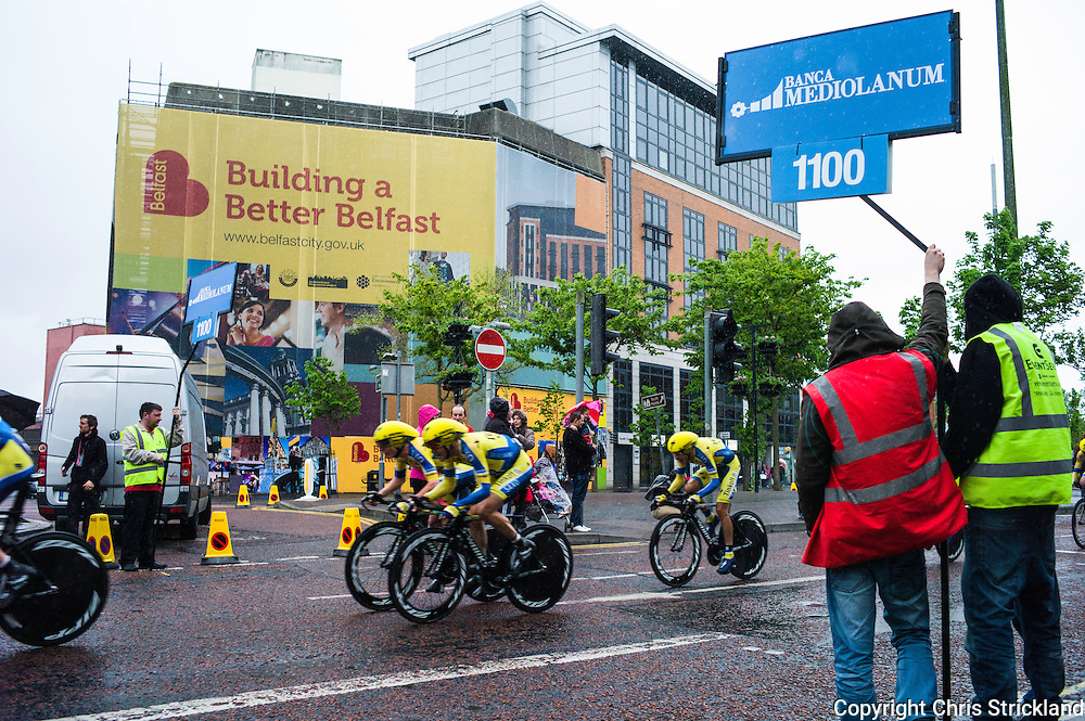 Belfast, Northern Ireland, 9th May, 2014. Team Tinkoff Saxo in action during the TTT in which they finished in 4th with a time of 25.05, keeping Irish rider Nicholas Roche in touch with the the main contenders. The Giro is a three week long stage race and is one of the toughest endurance sporting challenges. The first race was in 1909, and there have been nine starts outside of Italy, which take place to help export the Giro brand.