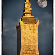 "In this ""Signature Series"" image by David Longstreath the moon rises over the most holy shrine in all of Laos, That Luang, in Vientiane."