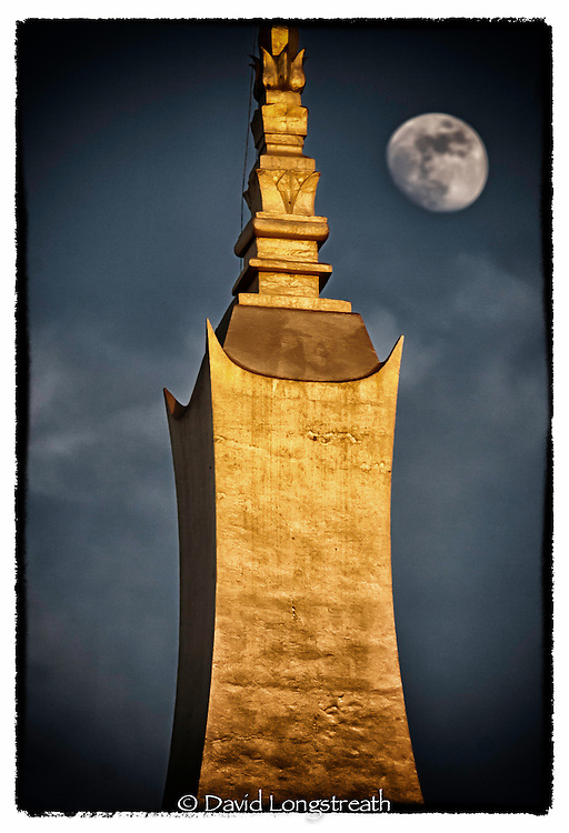 """In this """"Signature Series"""" image by David Longstreath the moon rises over the most holy shrine in all of Laos, That Luang, in Vientiane."""