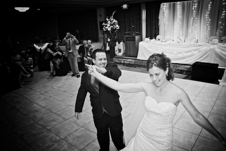 The newlyweds first dance, captured after dinner at their wedding reception. <br /> <br /> To view Katie and Brad's complete Wedding Gallery Collection, visit the Client Area and log-in. You'll be able to view all images as a slideshow, order prints and more.<br /> <br /> &copy; Images of a Promise by Dean Oros Photo + Design