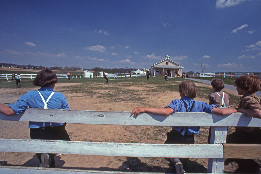 Boys play baseball at the former Nichol Mine Amish School, Lancaster Pennsylvania.