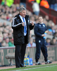 Guus Hiddink the new manager of Chelsea signals to his players during the Barclays Premier League match between Aston Villa and Chelsea at Villa Park on February 21, 2009 in Birmingham, England.