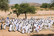 At the end of the month of Ramadan, the Muslim fasting period, nearly all of the families in the sprawling Breidjing Refugee Camp celebrated the festival of Eid al-Fitr. Many of the Sudanese refugees went to services at an improvised mosque; afterward, the imam led a procession around the camp, singing songs and delivering periodic homilies to segregated groups of men and women. (Supporting image from the project Hungry Planet: What the World Eats.)