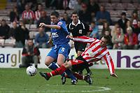 Photo: Pete Lorence.<br />Lincoln City v Rochdale United. Coca Cola League 2. 21/10/2006.<br />Lincoln's Lee Frecklington brings down Rochdale's John Doolan.