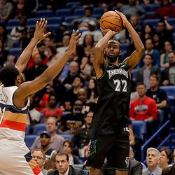 Dec 31, 2018; New Orleans, LA, USA; Minnesota Timberwolves forward Andrew Wiggins (22) shoots over New Orleans Pelicans forward Darius Miller (21) during the first quarter at the Smoothie King Center. Mandatory Credit: Derick E. Hingle-USA TODAY Sports