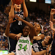 Stefanie Dolson, Connecticut, rebounds over Markisha Wright, Notre Dame, and team mate Kelly Faris, (right) during the Connecticut V Notre Dame Final match won by Notre Dame during the Big East Conference, 2013 Women's Basketball Championships at the XL Center, Hartford, Connecticut, USA. 11th March. Photo Tim Clayton
