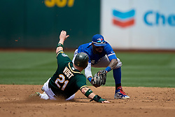 OAKLAND, CA - JULY 23:  Stephen Vogt #21 of the Oakland Athletics is forced out at second base by Jose Reyes #7 of the Toronto Blue Jays during the third inning at O.co Coliseum on July 23, 2015 in Oakland, California. The Toronto Blue Jays defeated the Oakland Athletics 5-2. (Photo by Jason O. Watson/Getty Images) *** Local Caption *** Stephen Vogt; Jose Reyes