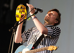 © Licensed to London News Pictures. 06/06/2015. London, UK.   Django Django performing live at Field Day Festival Saturday Day 1.  In this picture - Vincent Neff.  Django Django are a British art rock band composed of members  David Maclean (drummer and producer), Vincent Neff (singer and guitarist), Jimmy Dixon (bassist), and Tommy Grace (synthesizer)    Photo credit : Richard Isaac/LNP