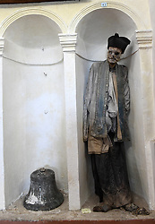 "NO WEB FOR FRANCE - At the crypt of the Mother Church dedicated to San Nicolò of Bari in Gangi, Sicily, Italy on January 2019 one can discover standing well aligned in niches, the well conserved mummies of 44 priests of the parish ""Once a month"", Father Don Giuseppe known as Pinot said, ""I celebrate the mass here surrounded by my faithful and by my fellows. They remind us that we are passing through this earth and they are still part of our lives years after their departure. You will notice that each one of them displays above their heads a eulogy in the form of a poem retracing their lives.""<br /> Sicily will reveal over time a real research laboratory on mummification. It is spreading throughout the island and there is not an important village in sight that does not display the bodies of their priests, monks or citizens in the crypt of their church. Photo by Eric Vandeville/ABACAPRESS.COM"