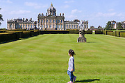 The child of a tourist is walking in the park of Castle Howard, near York, Yorkshire, England, United Kingdom.