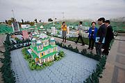 Atameken - Kazakhstan in a nutshell. South Korean tourists visiting the model of the former capital Almaty.
