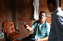Roberto Hernandez is one of over 1000 Cuban doctors working in Venezuela as part of a government health program.  Hernandez, 38, has spent 2 months of a 2 year stint working in San Pablito, a poor community in Caracas.  Originally from Cien Fuegos, Hernandez has also worked in Angola and the Carribean, spending 2 years in each location.
