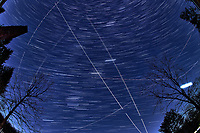 Winter Nighttime Sky Over New Jersey. Composite star trail image (19:30 - 19:59) taken with a Nikon D850 camera and 8-15 mm fisheye lens (ISO 800, 15 mm, f/8, 30 sec). Raw images processed with Capture One Pro and the composite created with Photoshop CC (statistics, maximum).