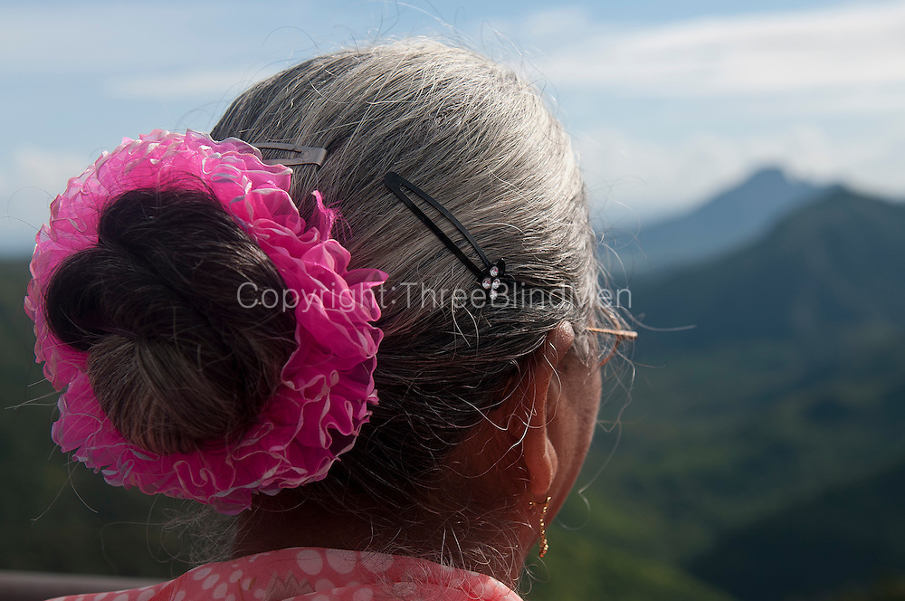 Woman with pink in her hair.