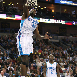 Feb 17, 2010; New Orleans, LA, USA; New Orleans Hornets forward Julian Wright (32) dunks the ball against the Utah Jazz during the second quarter at the New Orleans Arena. Mandatory Credit: Derick E. Hingle-US PRESSWIRE