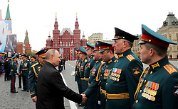 May 9, 2017 - Moscow, Russia - May 9, 2017. - Russia, Moscow. - Military parade on 72nd anniversary of victory in Great Patriotic War on Red Square. Russian President Vladimir Putin, Supreme Commander-in-Chief of the Russian Armed Forces, (2nd left), and Russian Defense Minister Sergey Shoigu  (Credit Image: © Russian Look via ZUMA Wire)