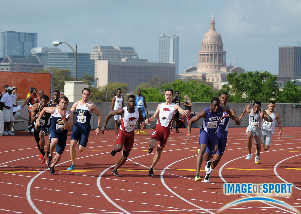 Mar 28, 2014; Austin, TX, USA; General view of runners handing off the baton on the anchor leg of a 4 x 100m relay head with the Texas State Capitol building as a backdrop during the 87th Clyde Littlefield Texas Relays at Mike A. Myers Stadium.