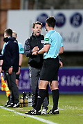 Dundee manager Neil McCann questions fourth official Mat Northcross over the foul by John McGinn (#7) of Hibernian on Glen Kamara (#8) of Dundee during the Ladbrokes Scottish Premiership match between Dundee and Hibernian at Dens Park, Dundee, Scotland on 24 January 2018. Photo by Craig Doyle.