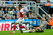 Federico Fernandez (#18) of Newcastle United slides in to win the ball denying Pierre-Emerick Aubameyang (#14) of Arsenal a clear run on goal during the Premier League match between Newcastle United and Arsenal at St. James's Park, Newcastle, England on 15 September 2018.