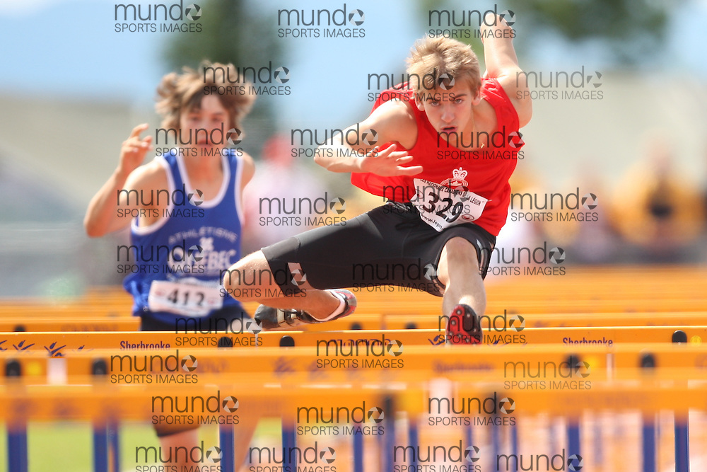 Sherbrooke, Quebec ---08/08/09---  Mitch O'Donnell of Ontario competes in the 100 metre hurdles at the 2009 Legion Canadian Youth Track and Field Championships in Sherbrooke, Quebec, August 10, 2009..HO/ Athletics Canada (credit should read GEOFF ROBINS/Mundo Sport Images/ Athletics Canada)..