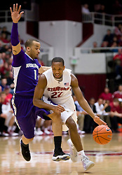 February 13, 2010; Stanford, CA, USA;  Stanford Cardinal guard Jarrett Mann (22) is defended by Washington Huskies guard Venoy Overton (1) during the first half at Maples Pavilion.  Washington defeated Stanford 78-61.