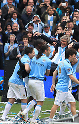 © Licensed to London News Pictures. London, UK. 11/05/2014. London, UK.  Manchester City manager, Manuel Pellergrini celebrates with the team after  winning the Barclays Premier League at the Etihad Stadium. .Photo credit: LNP
