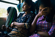 A Sri Lankan family rides the train through hill country, Ella, Sri Lanka, Asia