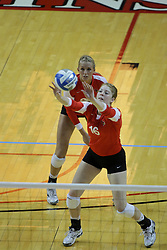 06 November 2010: Mallory Leggett watches as Shannon McGlaughlin passes the ball forward during an NCAA volleyball match between the Purple Aces of the University of Evansville and the Illinois State Redbirds at Redbird Arena in Normal Illinois.