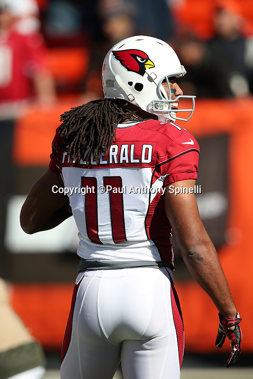 Arizona Cardinals wide receiver Larry Fitzgerald (11) has a hearty laugh while warming up before the 2015 week 8 regular season NFL football game against the Cleveland Browns on Sunday, Nov. 1, 2015 in Cleveland. The Cardinals won the game 34-20. (©Paul Anthony Spinelli)
