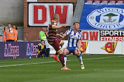 Wigan Athletic Midfielder, Max Power (6) and Queens Park Rangers Defender, Jake Bidwell (3) during the EFL Sky Bet Championship match between Wigan Athletic and Queens Park Rangers at the DW Stadium, Wigan, England on 27 August 2016. Photo by Mark Pollitt.
