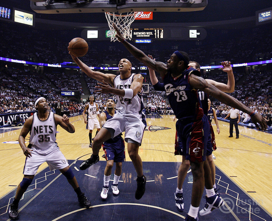 The Nets' Richard Jefferson (2nd from L) drives to the basket as the Cavaliers' LeBon James (R) tries to defend him during the second half of game 6 of the Eastern Conference semifinals between the Cleveland Cavaliers and the New Jersey Nets at Continental Airlines Arena in East Rutherford, New Jersey on 18 May 2007. The Cavaliers' defeated the Nets 88-72 and as a result won their series, 4-1.