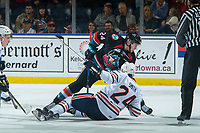 KELOWNA, CANADA - SEPTEMBER 22:  Luc Smith #24 of the Kamloops Blazers falls to the ice after the face off against Kyle Topping #24 of the Kelowna Rockets on September 22, 2018 at Prospera Place in Kelowna, British Columbia, Canada.  (Photo by Marissa Baecker/Shoot the Breeze)  *** Local Caption ***
