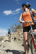 Young couple cycling in mountains