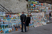 Tourist art is on display along Zanlek Ksiazat Czartoryskich, beneath the reconstituted city walls of the Florian Gate, on 22nd September 2019, in Krakow, Malopolska, Poland.