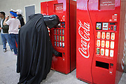 UNITED KINGDOM, London: 27 May 2018 A cosplay fan dressed as Darth Vader gets a refreshing drink at the MCM London Comic Con earlier today. The three day comic convention, which is held at London's ExCeL, was visited by thousands of avid cosplay fans and enthusiasts. Rick Findler / Story Picture Agency