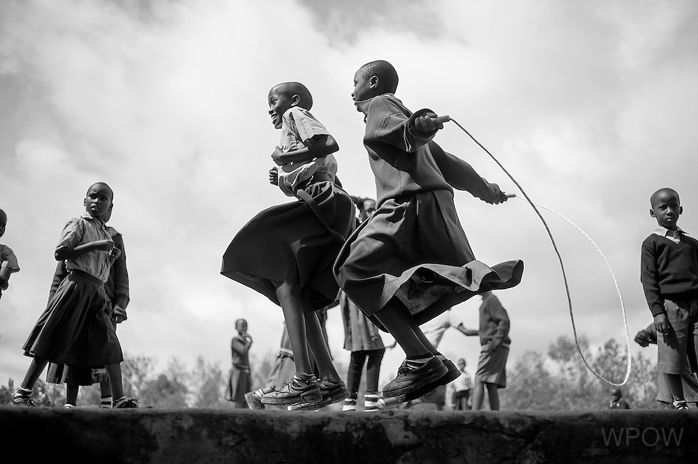 Girls jump rope together during recess in Karanse, Tanzania. Though problems persist, Tanzania is making significant strides towards gender parity in primary education, as seen in this school, where boys and girls are equally represented. (photo by Erin Scott)