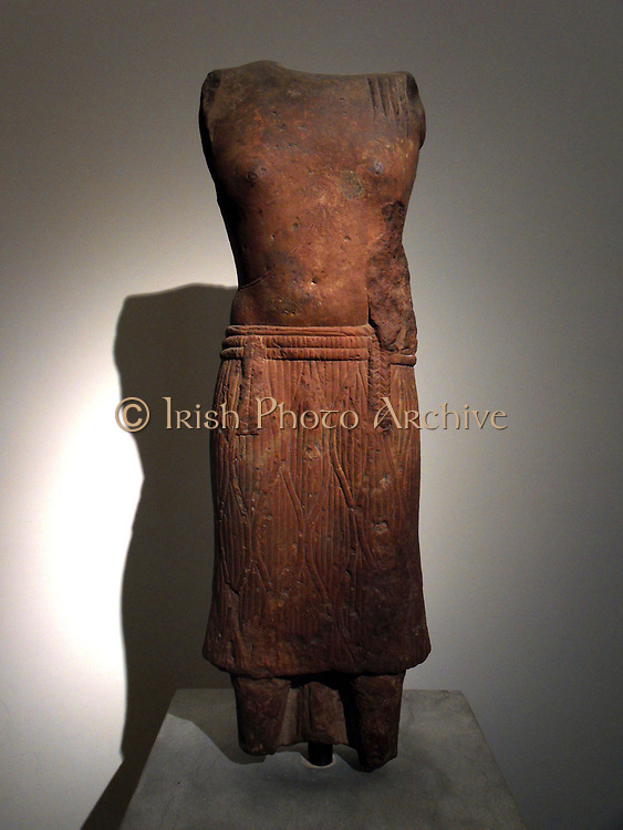 Torso of Brahmanic ascetic early 2nd century. Kushan dynasty (1st-3rd AD) Buddhist red sandstone sculpture from Mathura in India.