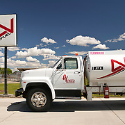 White fuel truck parked next to sign, Avfuel, AVCenter, Nampa, Idaho, USA