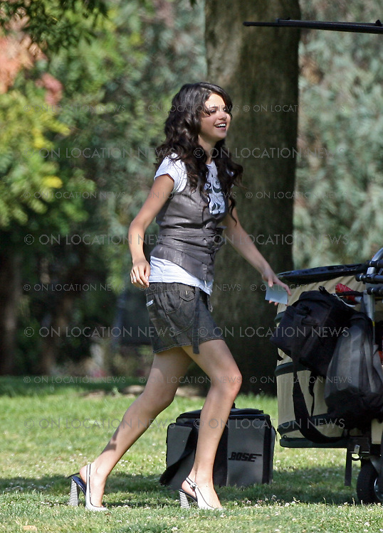 "LOS ANGELES, CALIFORNIA - FRIDAY 25th APRIL 2008. EXCLUSIVE: Selena Gomez (born July 22, 1992) on the set of a People Magazine photo shoot. Selena is expected to be the next tween queen.  Selena is an American actress and singer. Her first role was on Barney & Friends as Gianna. She was discovered by Disney in a nation wide Disney talent search when she was 12 years old. She is currently starring as Alex Russo on the Disney Channel's Original Series,  Wizards of Waverly Place which premiered in October 2007.  Gomez also has a career as a singer, and has recorded three songs for Walt Disney Records. She released a music video for her song ""Cruella De Vil"" for the premiere of Disney's 101 Dalmatians in February 2008. In 2007, she appeared in the second-season episodes of Hannah Montana as Mikayla, a pop star who is a rival of Hannah Montana..She is also currently co-starring with Drew Seeley in the sequel to the hit movie A Cinderella Story called Another Cinderella Story as the main character Mary. Photograph: On location News. Sales: Eric Ford 1/818-613-3955 info@OnLocationNews.com"